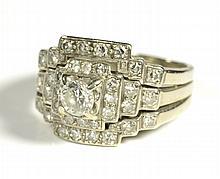 DIAMOND AND FOURTEEN KARAT WHITE GOLD RING,
