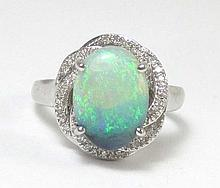 OPAL, DIAMOND AND FOURTEEN KARAT WHITE GOLD RING,