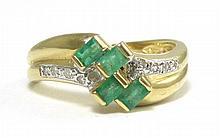 EMERALD, DIAMOND AND FOURTEEN KARAT GOLD RING, set