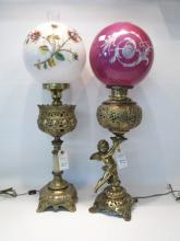 TWO ELECTRIFIED VICTORIAN FLUID OIL LAMPS, the mil