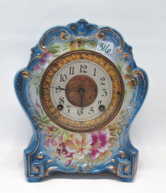A ROYAL BONN/ANSONIA PORCELAIN SHELF CLOCK, with t