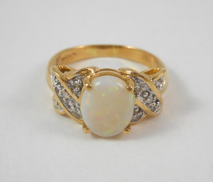 OPAL, DIAMOND AND FOURTEEN KARAT GOLD RING. The y