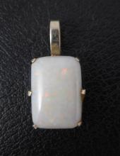 OPAL AND FOURTEEN KARAT WHITE GOLD PENDANT, set wi