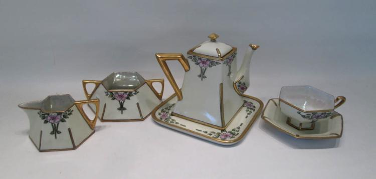EIGHTEEN PIECE PORCELAIN TEA SET consisting of tea
