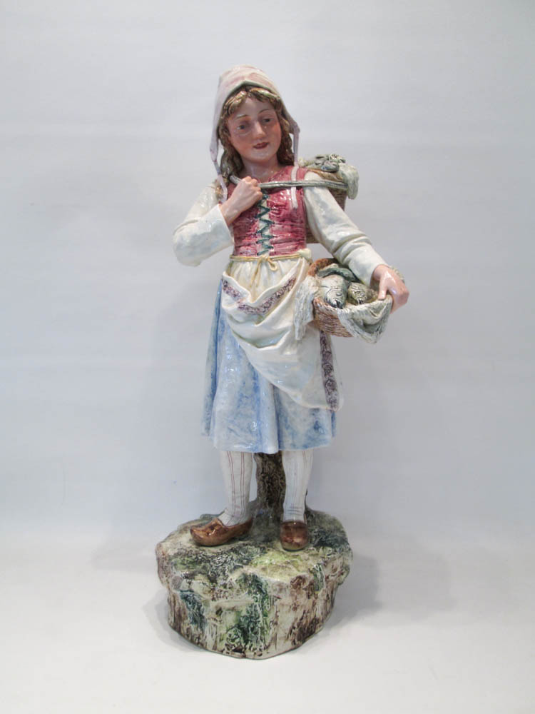 PORCELAIN FIGURAL SCULPTURE depicting a Dutch maid