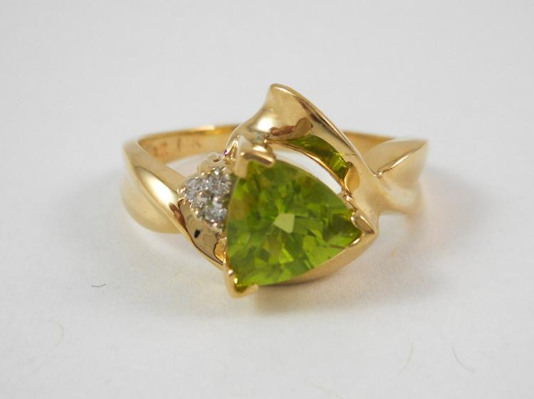 PERIDOT, DIAMOND AND FOURTEEN KARAT GOLD RING, set