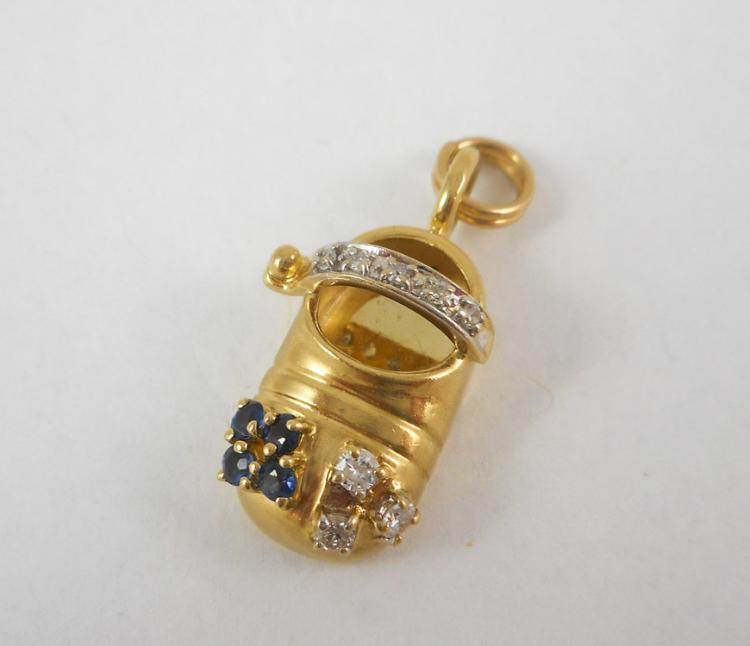 SAPPHIRE, DIAMOND AND FOURTEEN KARAT GOLD CHARM.