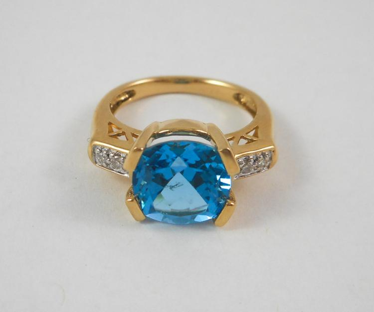 BLUE TOPAZ, DIAMOND AND FOURTEEN KARAT GOLD RING,