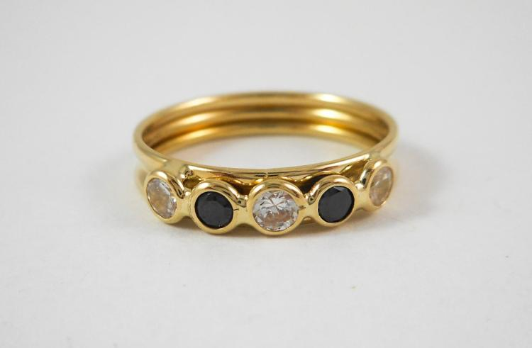 BLACK ONYX AND FOURTEEN KARAT GOLD RING, set with