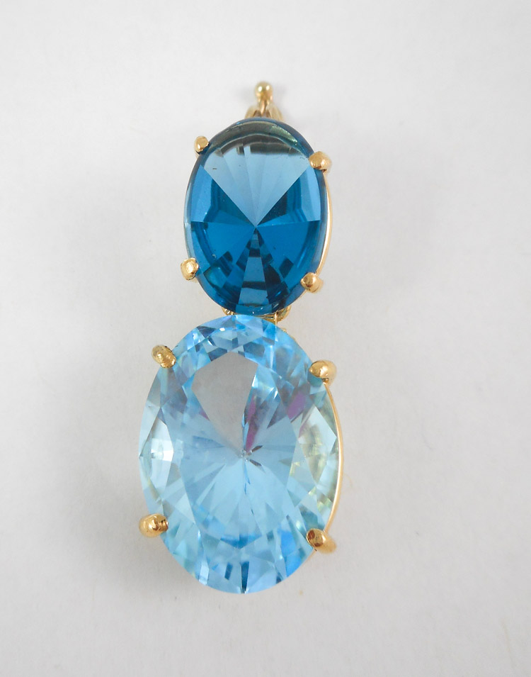 BLUE TOPAZ AND FOURTEEN KARAT GOLD PENDANT, set wi
