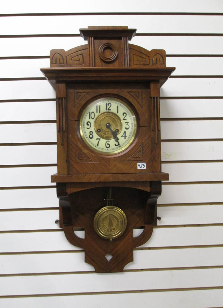 WALNUT CASED OPEN PENDULUM WALL CLOCK, Schlenker &