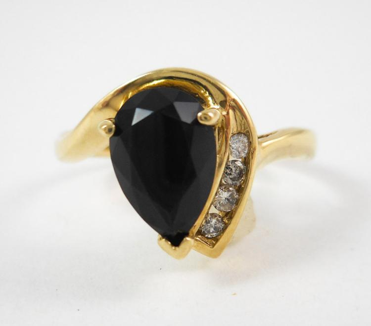 BLACK ONYX, DIAMOND AND TEN KARAT GOLD RING, with