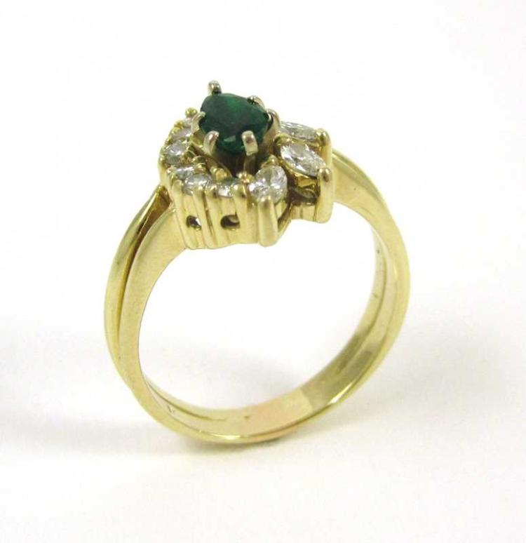 FOURTEEN KARAT GOLD, DIAMOND AND EMERALD RING, the