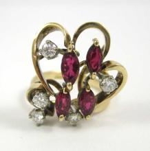RUBY, DIAMOND AND FOURTEEN KARAT GOLD RING, set wi