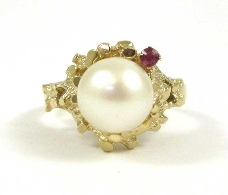 PEARL, RUBY AND FOURTEEN KARAT GOLD RING, set with