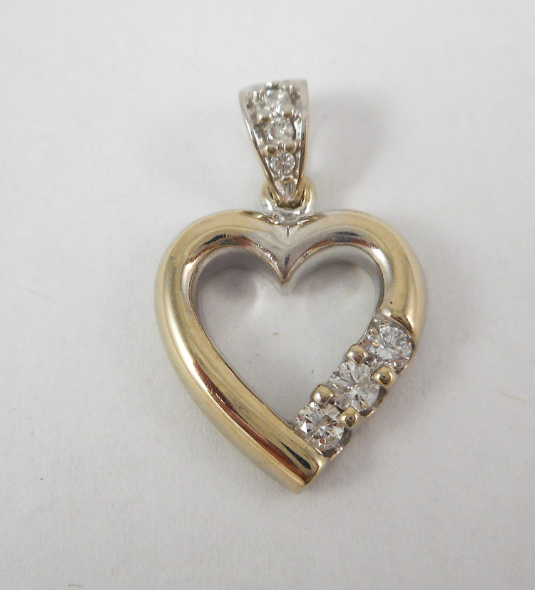 DIAMOND AND FOURTEEN KARAT WHITE GOLD PENDANT.  Th