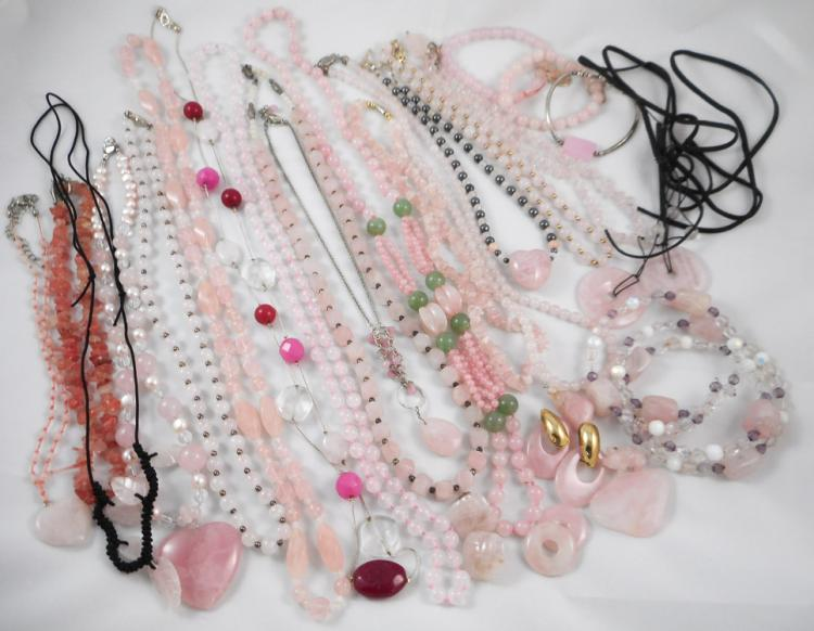 THIRTY-ONE PIECES OF ROSE QUARTZ JEWELRY including