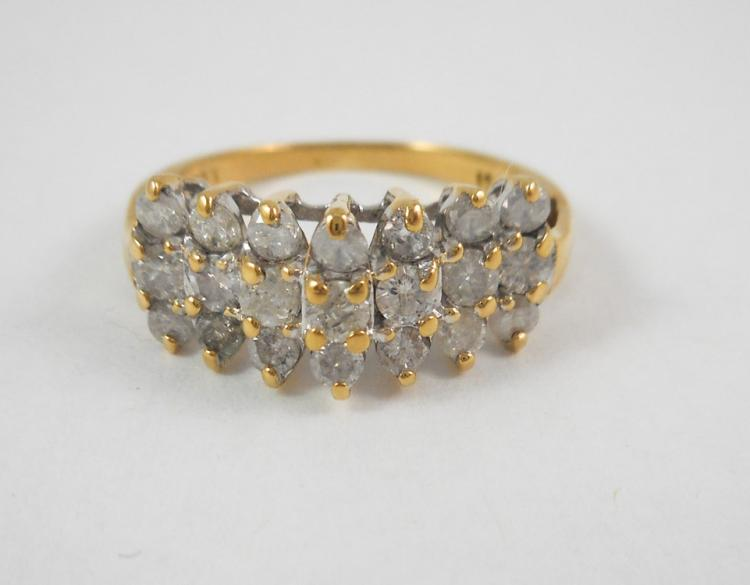 DIAMOND AND TEN KARAT YELLOW GOLD RING, set with 2
