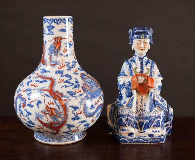 TWO CHINESE PORCELAINS: figure of a seated Chines