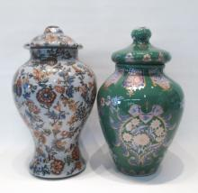 TWO EGLOMISE LIDDED URNS, reverse painted in flora