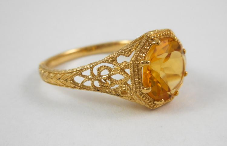 CITRINE AND FOURTEEN KARAT GOLD RING.  The yellow