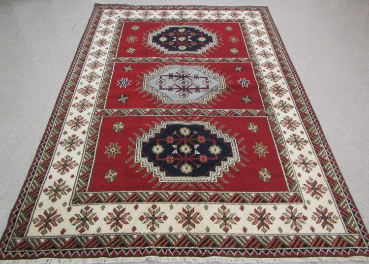 HAND KNOTTED ORIENTAL CARPET, three geometric meda