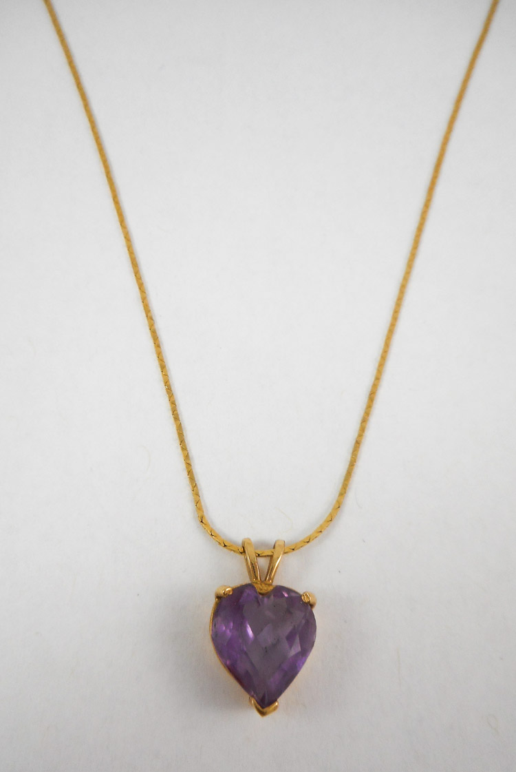 AMETHYST AND FOURTEEN KARAT GOLD PENDANT NECKLACE,