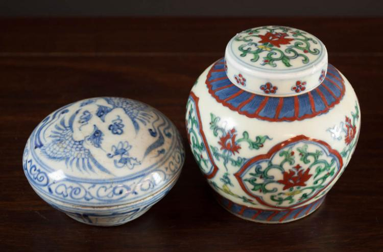 TWO CHINESE PORCELAIN LIDDED JARS, the first Ming