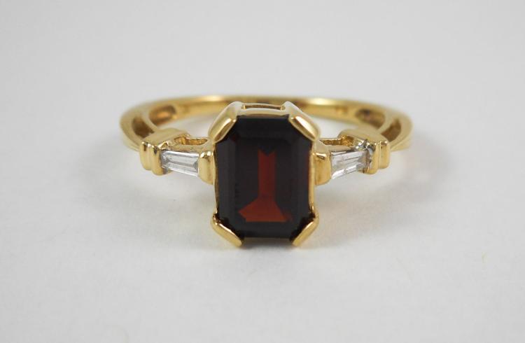 GARNET, DIAMOND AND TEN KARAT GOLD RING, with a ba