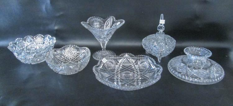 SIX CUT CRYSTAL TABLEWARE PIECES including a compr