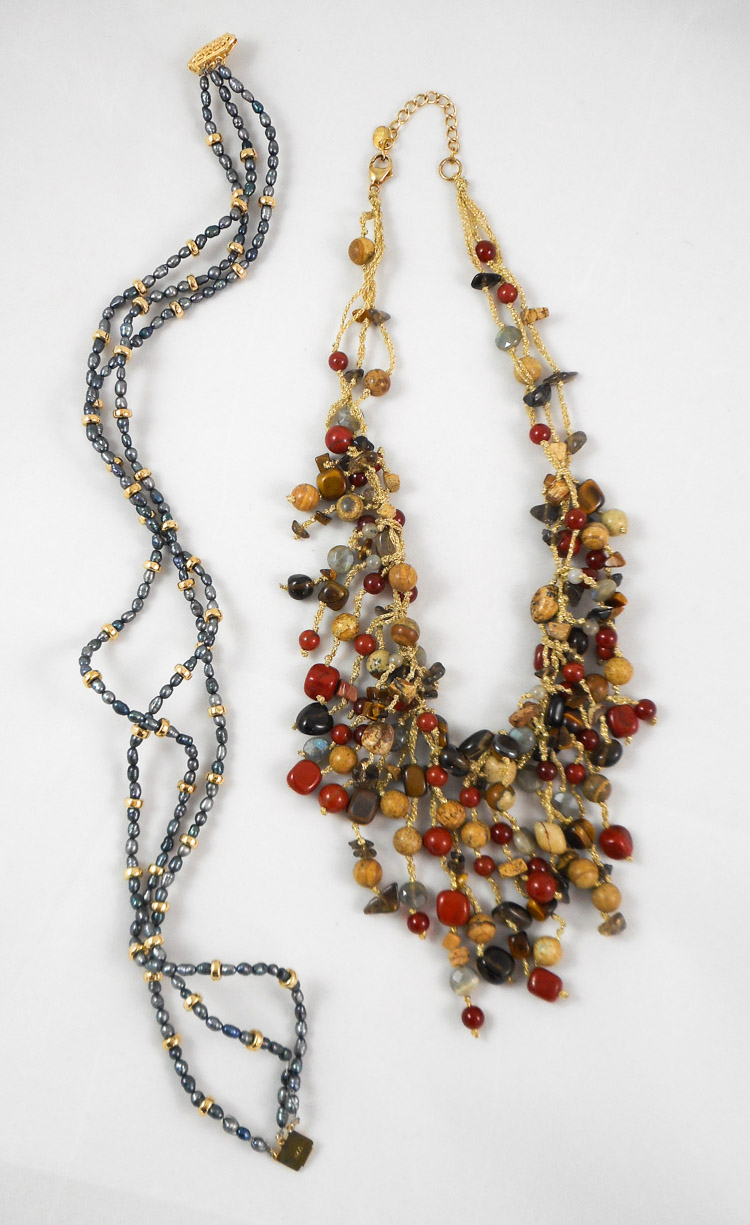 TWO BEAD NECKLACES, including a 15 inch triple str