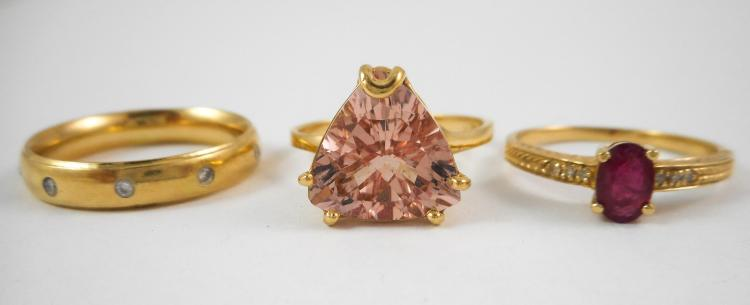 THREE FOURTEEN KARAT YELLOW GOLD RINGS, including