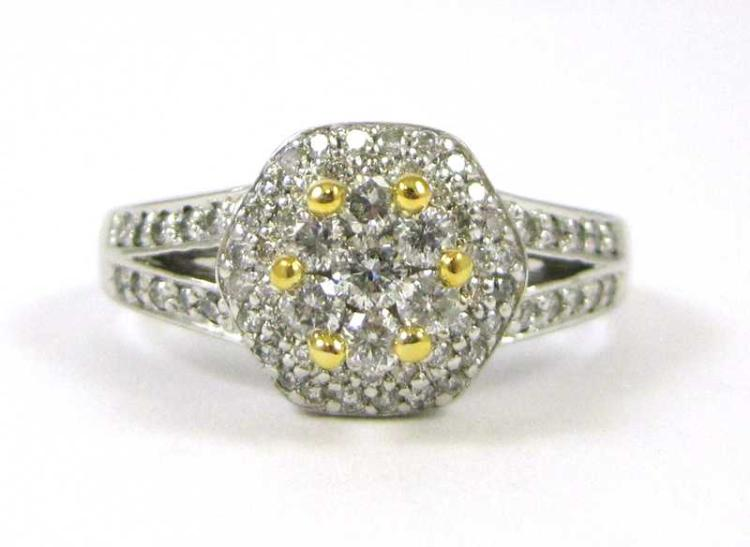 DIAMOND AND FOURTEEN KARAT GOLD RING.  The white a