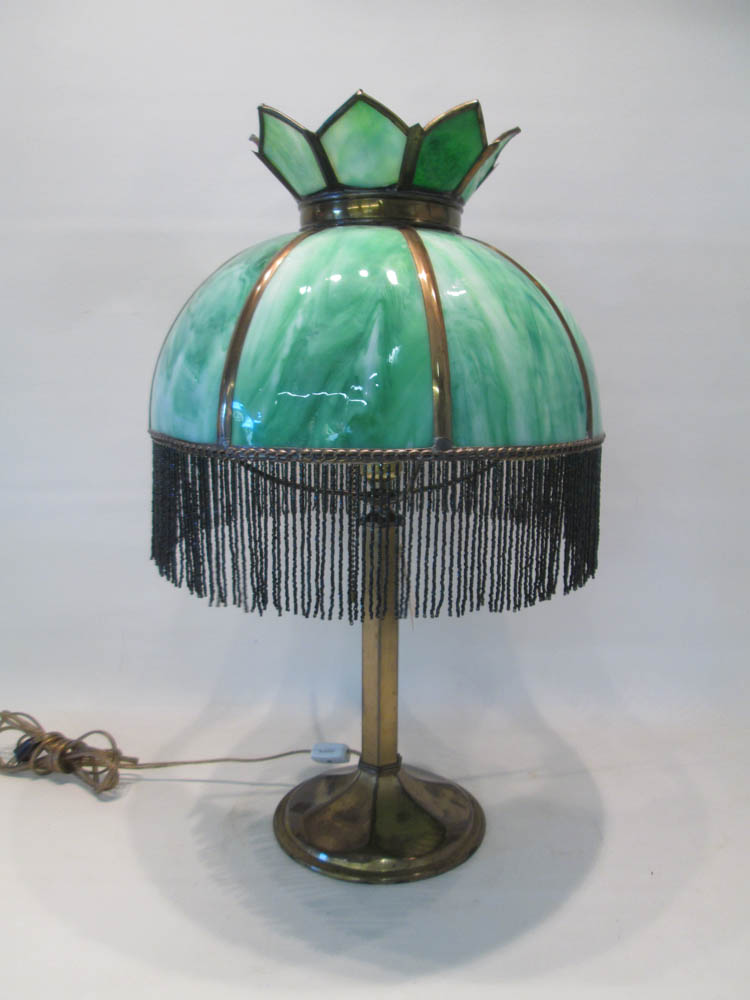 VICTORIAN STYLE SLAG GLASS LAMP having eight curve