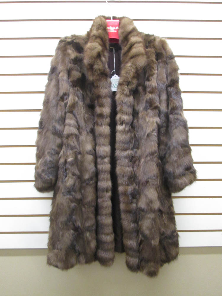 LADY'S MINK COAT, with three button closures and t