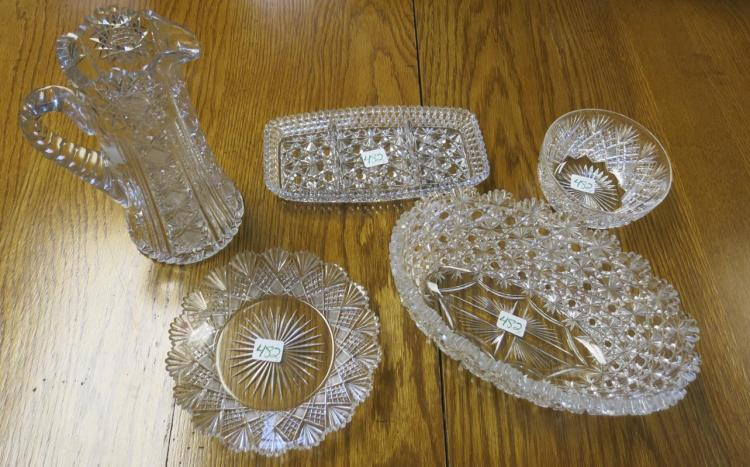 FIVE CUT CRYSTAL TABLEWARE PIECES including a pitc