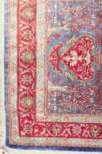 Lot 319: A CONTEMPORARY PERSIAN SILK PRAYER RUG, featuring