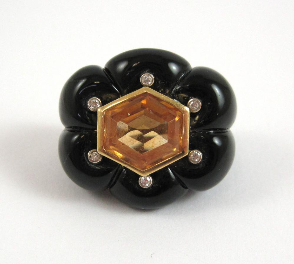 Lot 327: YELLOW SAPPHIRE, BLACK ONYX AND DIAMOND SCARF RING