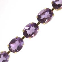 Lot 333: AMETHYST AND TEN KARAT GOLD BRACELET, measuring 7-