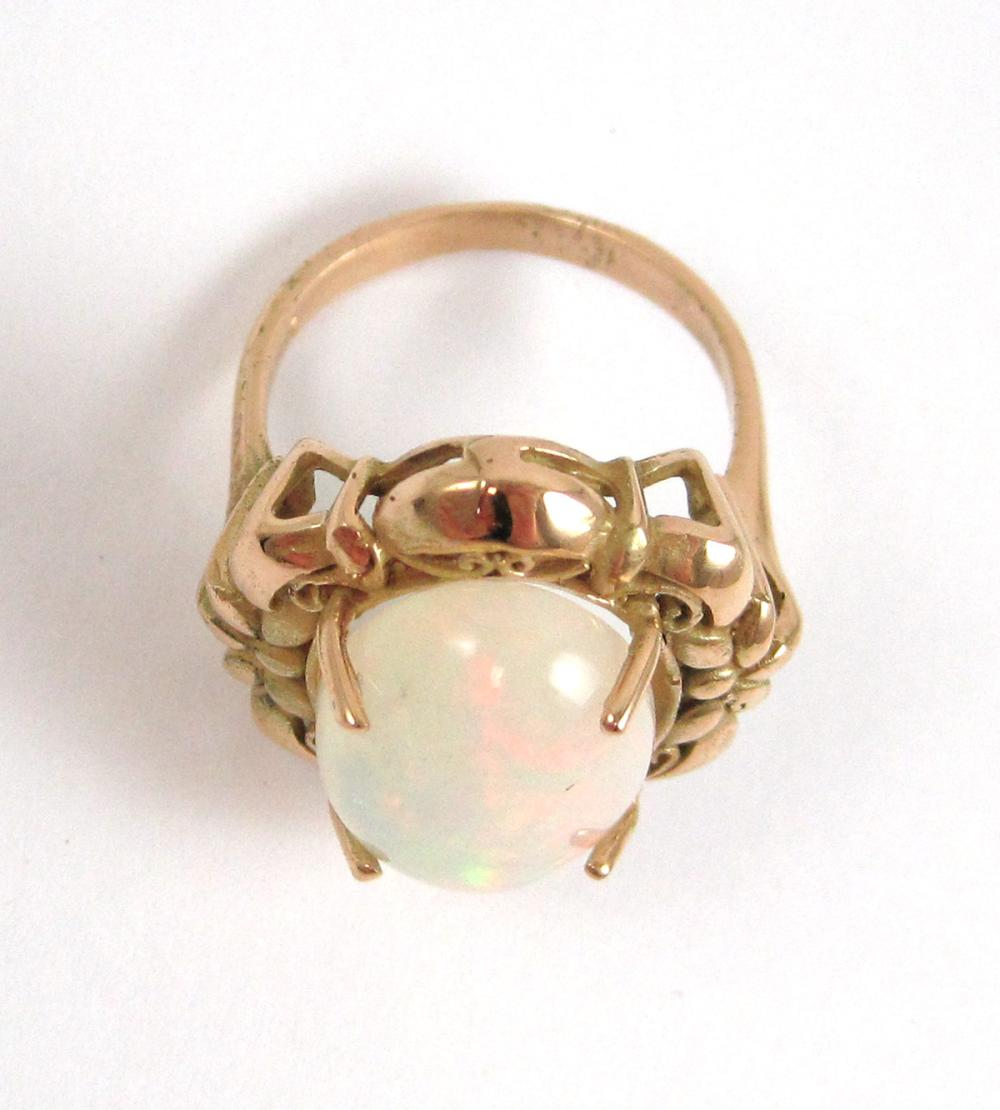 Lot 351: OPAL AND FOURTEEN KARAT GOLD RING, prong set with