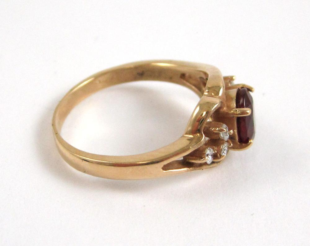 Lot 362: RUBY, DIAMOND AND FOURTEEN KARAT GOLD RING, with t