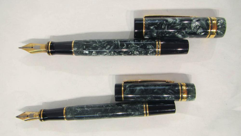 TWO PARKER FOUNTAIN PENS.  Both are Duofold in gre