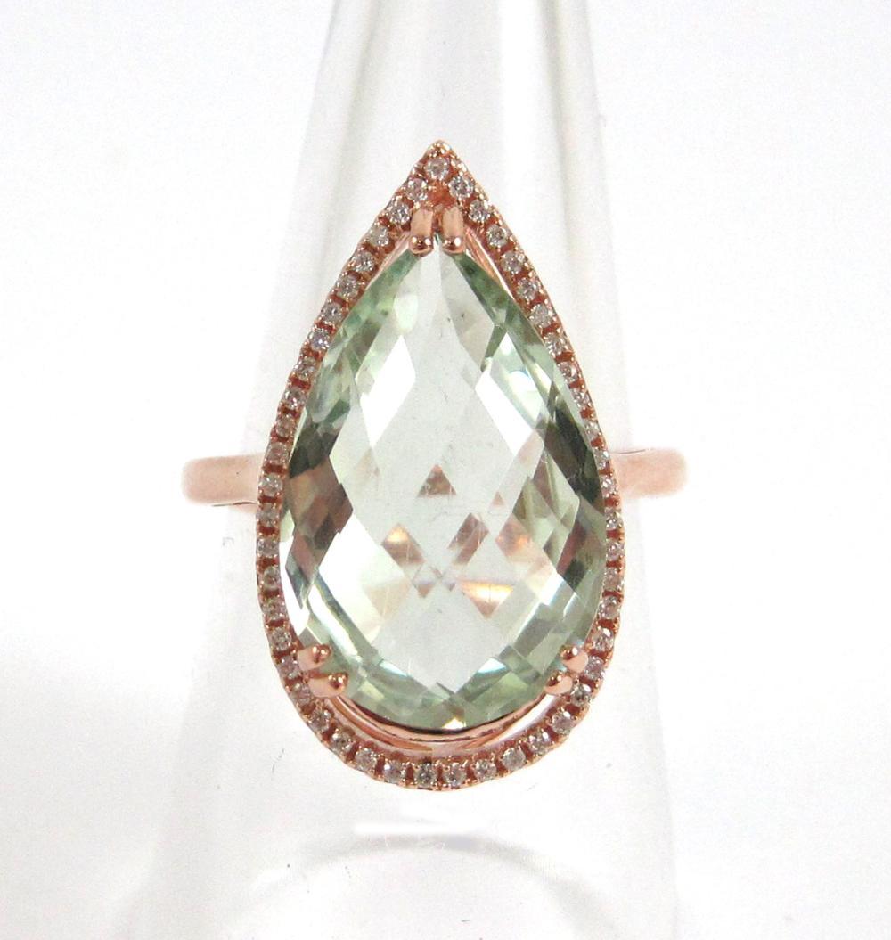 PRASIOLITE, DIAMOND AND FOURTEEN KARAT GOLD RING.