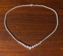 Lot 395: DIAMOND AND FOURTEEN KARAT WHITE GOLD NECKLACE. T