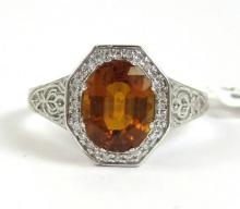 Lot 387: ORANGE SAPPHIRE, DIAMOND AND FOURTEEN KARAT GOLD R