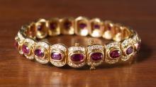 Lot 413: RUBY, DIAMOND AND EIGHTEEN KARAT GOLD BRACELET. T