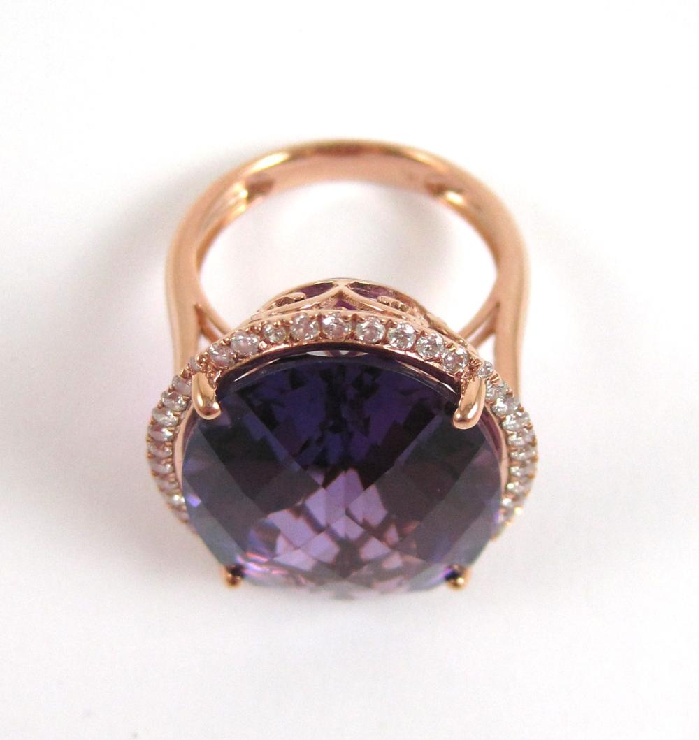Lot 425: AMETHYST, DIAMOND AND FOURTEEN KARAT GOLD RING. T