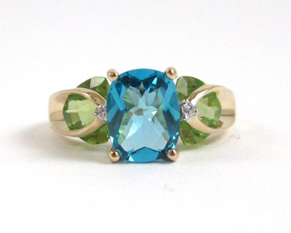 BLUE TOPAZ, PERIDOT AND DIAMOND RING.  The 14k yel
