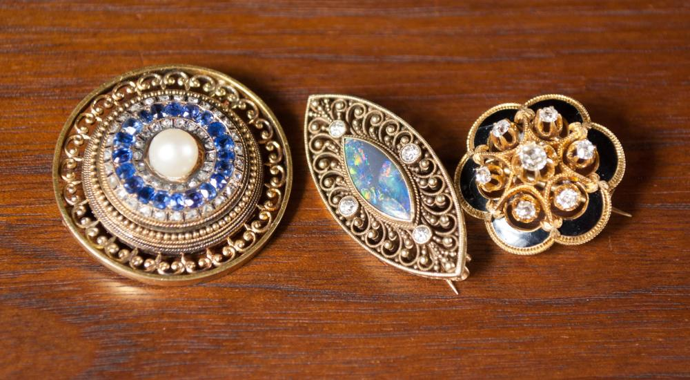 COLLECTION OF THREE YELLOW GOLD PINS:  1.) a round