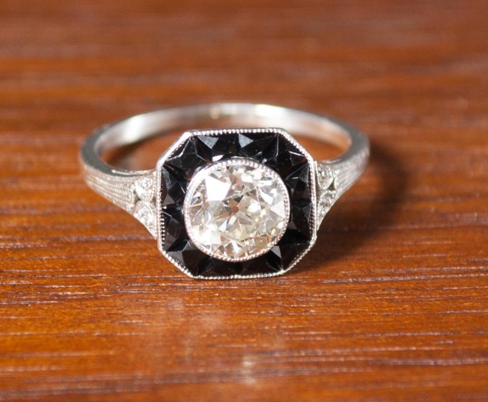 ART DECO DIAMOND, BLACK ONYX AND PLATINUM RING.  T